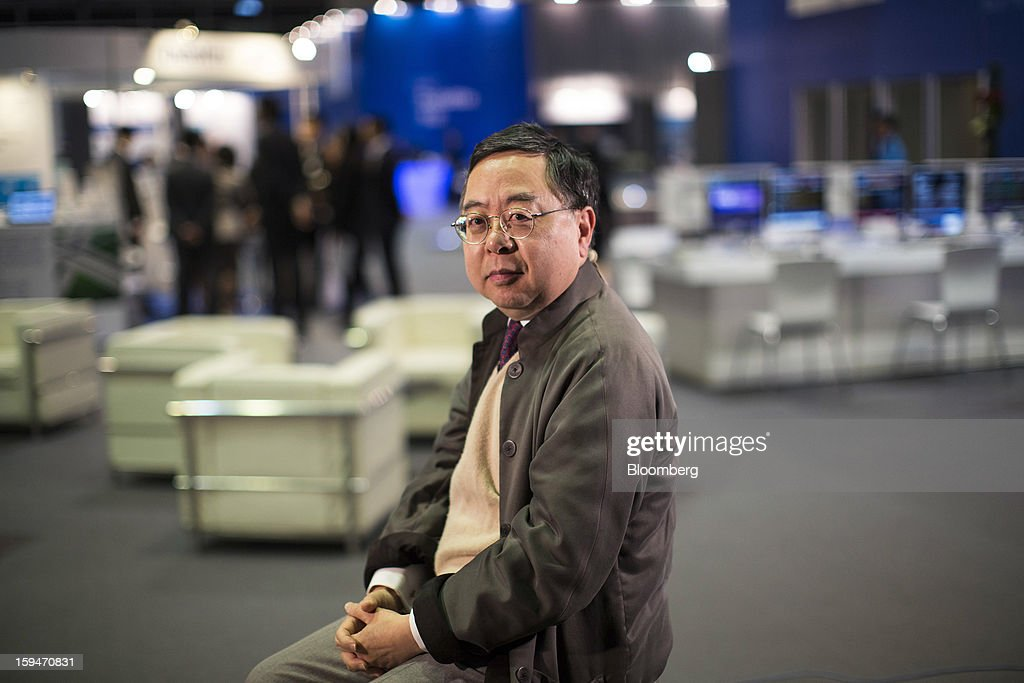 Ronnie Chan, chairman of Hang Lung Properties Ltd., sits for a photograph at the Asian Financial Forum in Hong Kong, China, on Monday, Jan. 14, 2013. The Asian Financial Forum runs until Jan. 15. Photographer: Jerome Favre/Bloomberg via Getty Images