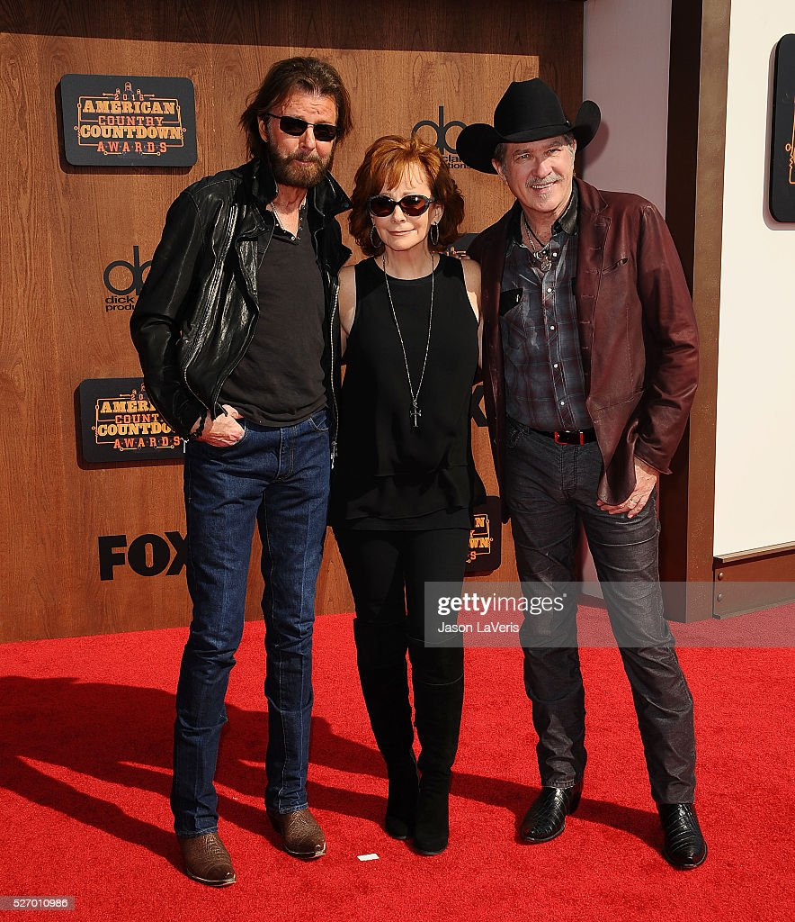 Ronnie Dunn and Kix Brooks of Brooks & Dunn and Reba McEntire attend the 2016 American Country Countdown Awards at The Forum on May 01, 2016 in Inglewood, California.