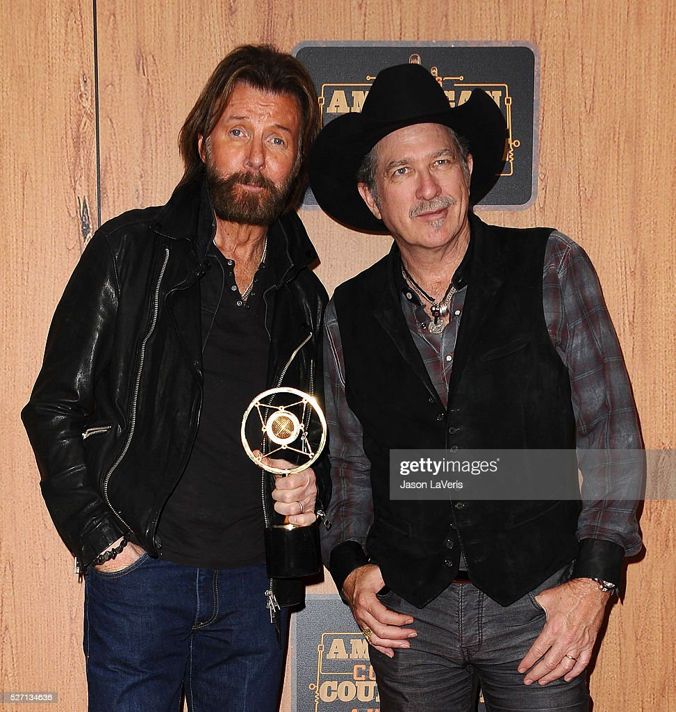 Ronnie Dunn and Kix Brooks of Brooks & Dunn pose in the press room at the 2016 American Country Countdown Awards at The Forum on May 01, 2016 in Inglewood, California.