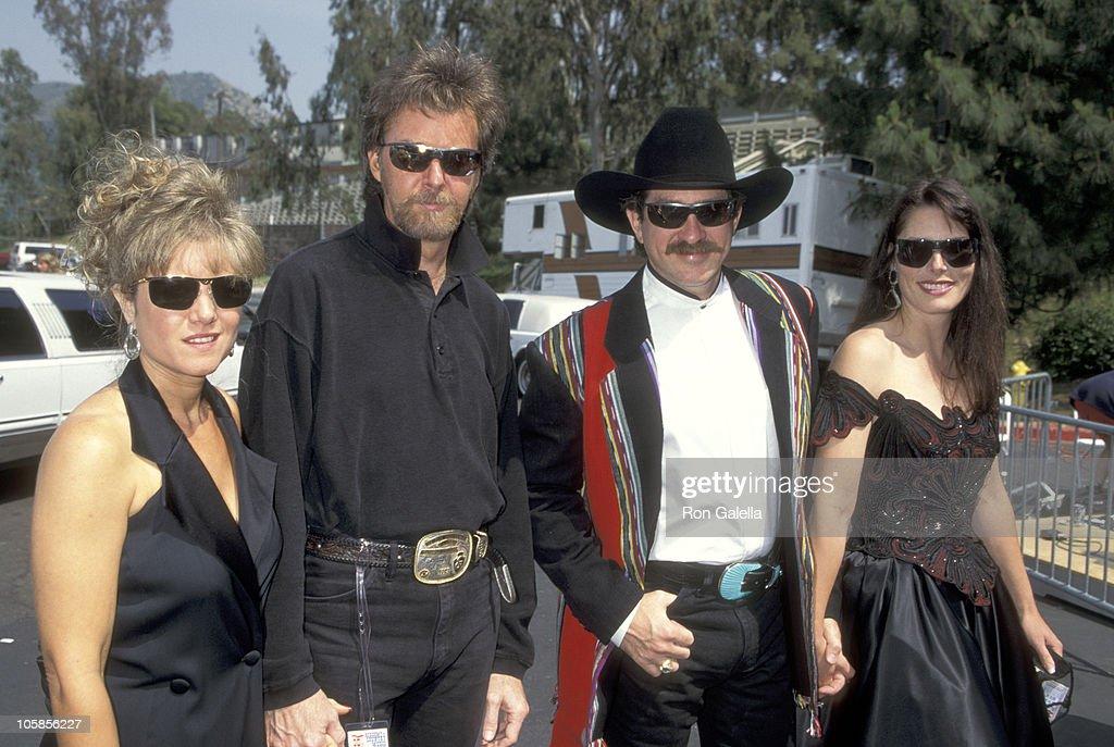 Ronnie Dunn and wife Janine Dunn, and Kix Brooks and wife Barbara Brooks