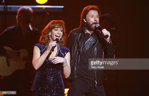 Ronnie Dunn of Brooks and Dunn and recording artist Reba McEntire perform onstage at the 49th annual CMA Awards at the Bridgestone Arena on November...