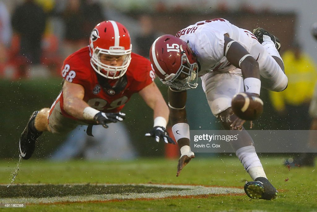 Ronnie Harrison of the Alabama Crimson Tide defends as Jackson Harris of the Georgia Bulldogs fails to pull in this reception at Sanford Stadium on...