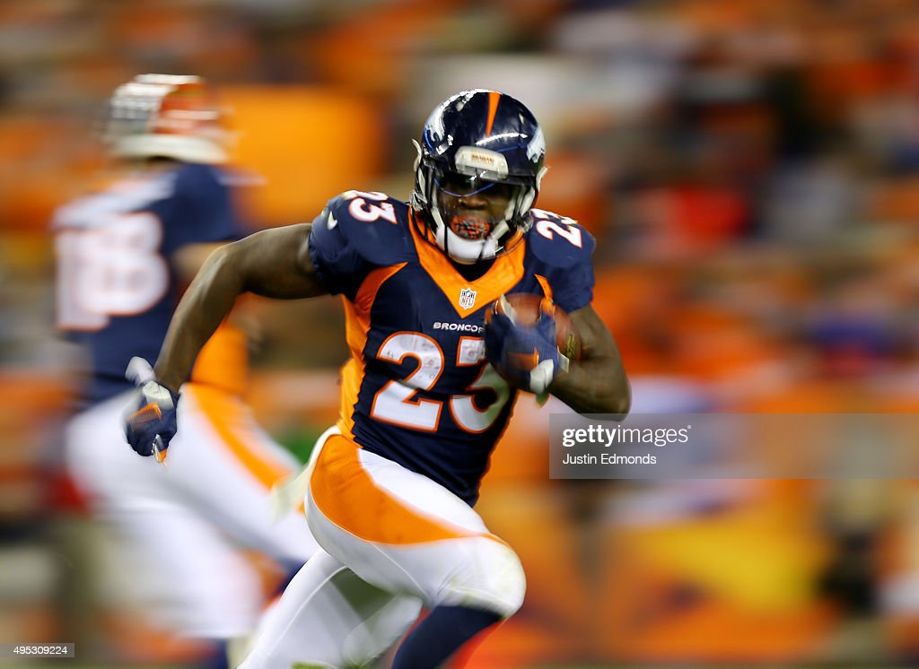 Ronnie Hillman of the Denber Broncos runs the ball against the Green Bay Packers in the fourth quarter at Sports Authority Field at Mile High on...