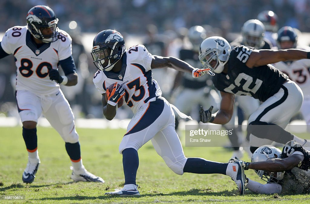 Ronnie Hillman of the Denver Broncos breaks free from the Oakland Raiders defense in the first half at Oco Coliseum on November 9 2014 in Oakland...