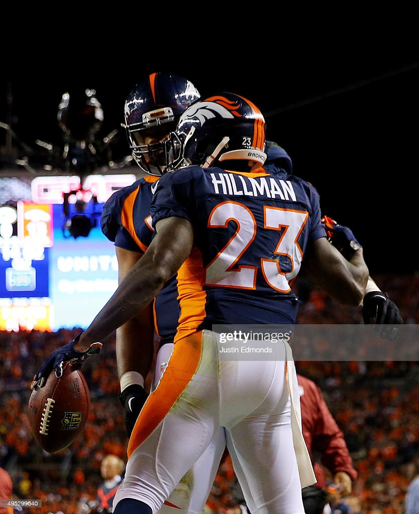 Ronnie Hillman of the Denver Broncos celebrates his touchdown with teammate Bennie Fowler against the Green Bay Packers in the second quarter at...