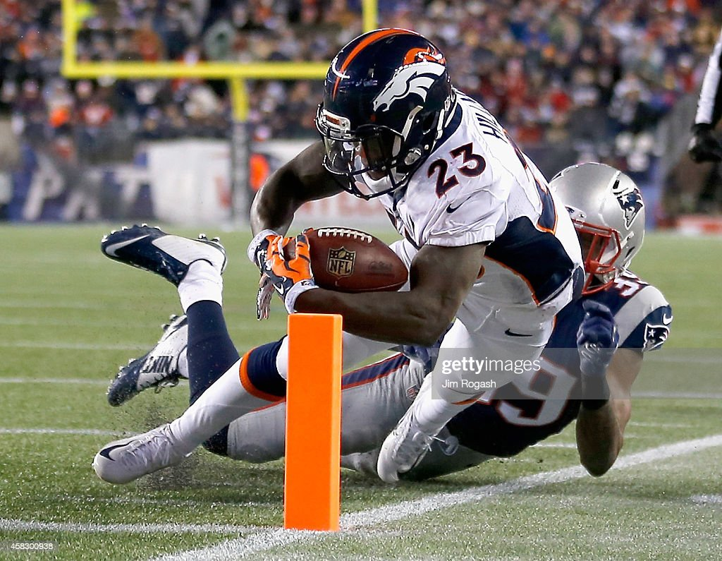Ronnie Hillman of the Denver Broncos dives as he scores a touchdown during the third quarter against the New England Patriots at Gillette Stadium on...