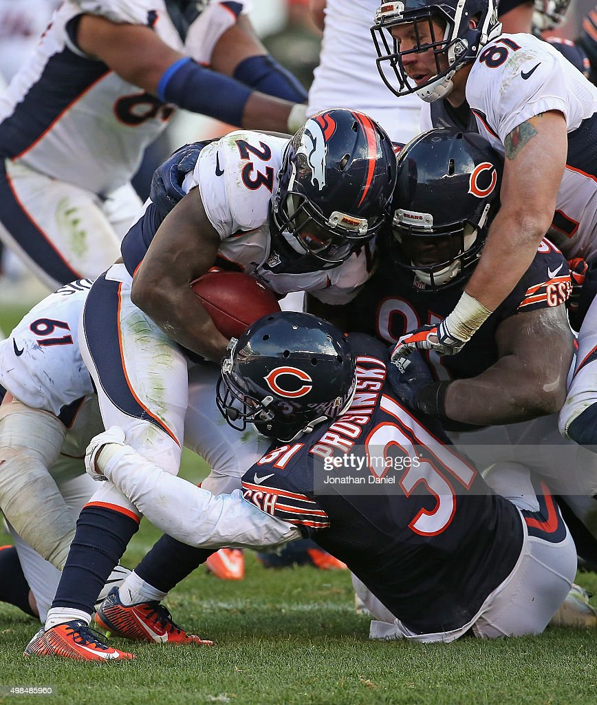 Ronnie Hillman #23 of the Denver Broncos is tackeld by Chris Prosinski #31 and Eddie Goldman #91 of the Chicago Bears at Soldier Field on November 22, 2015 in Chicago, Illinois. The Broncos defeated the Bears 17-15.