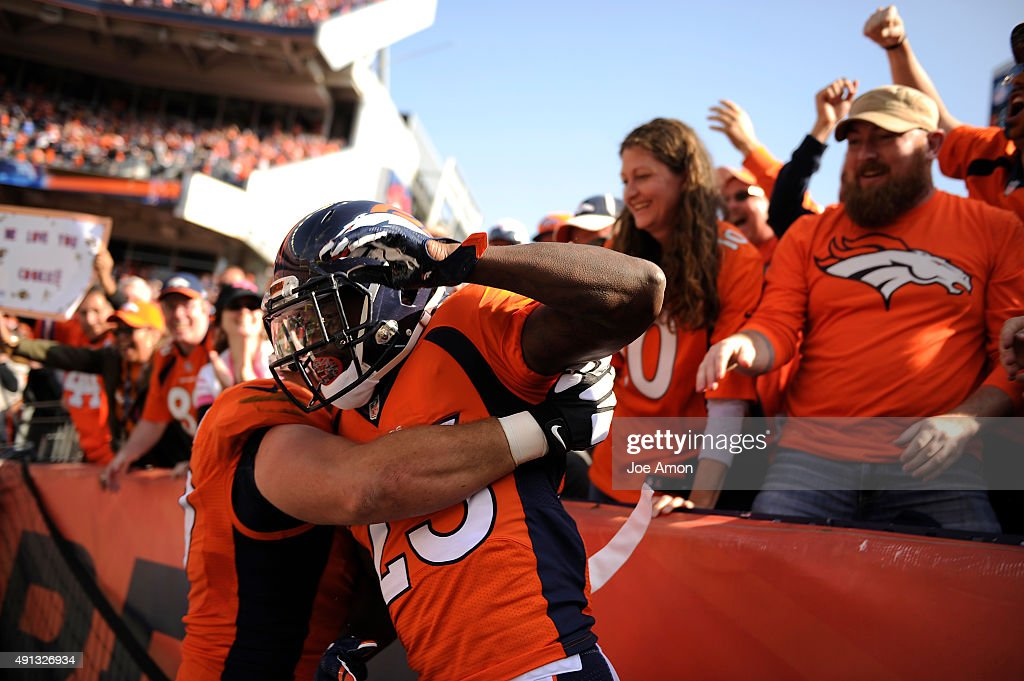 Ronnie Hillman of the Denver Broncos jumps down from the stands after a 72yard touchdown run The Denver Broncos played the Minnesota Vikings at...