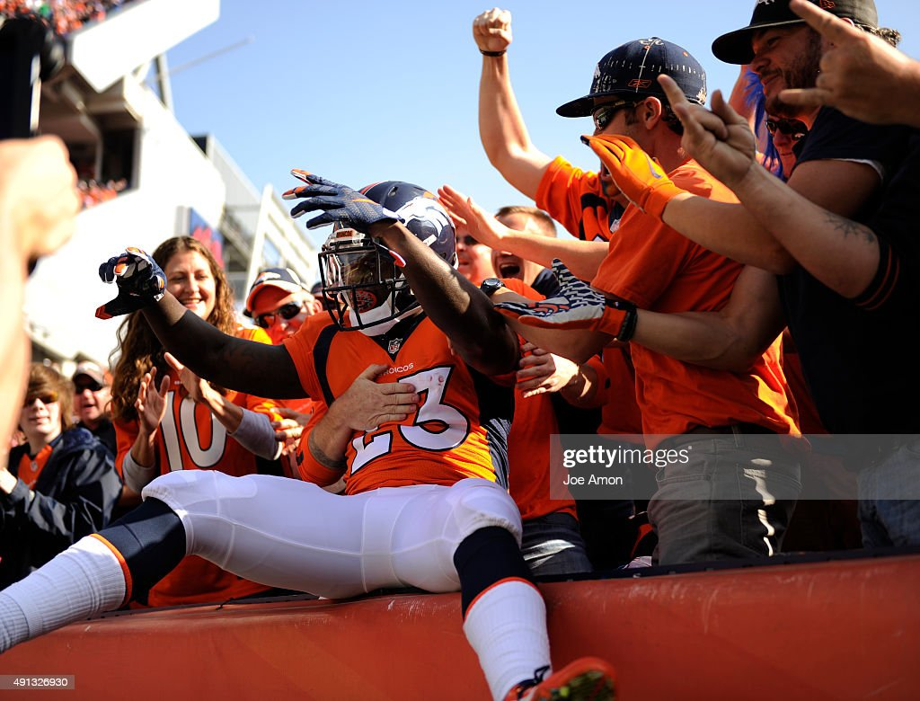 Ronnie Hillman of the Denver Broncos jumps in the stands after a 72yard touchdown run The Denver Broncos played the Minnesota Vikings at Sports...
