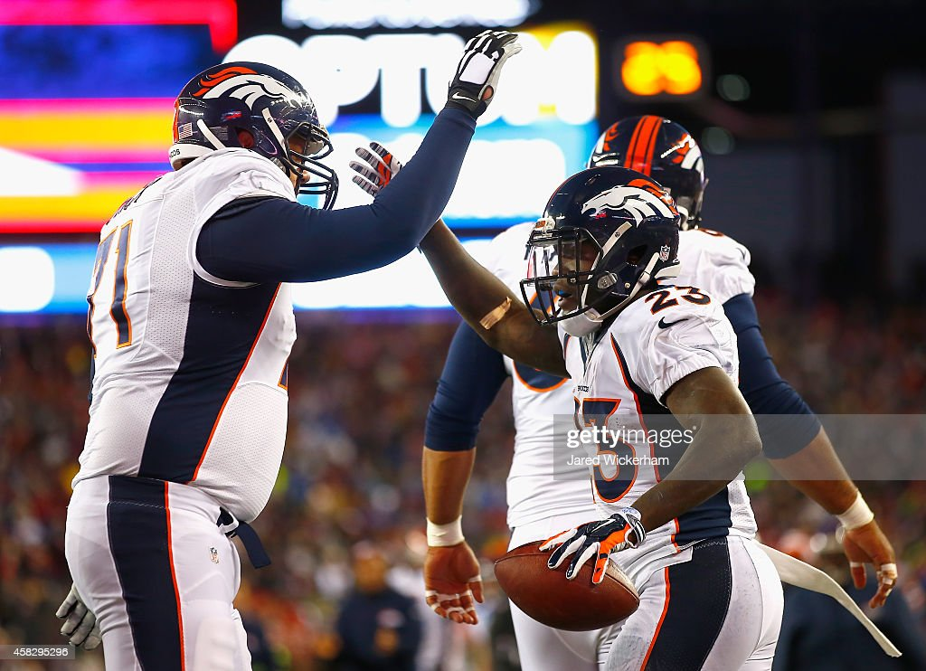 <a gi-track='captionPersonalityLinkClicked' href=/galleries/search?phrase=Ronnie+Hillman&family=editorial&specificpeople=7355403 ng-click='$event.stopPropagation()'>Ronnie Hillman</a> #23 of the Denver Broncos reacts after scoring a touchdown during the first quarter against the New England Patriots at Gillette Stadium on November 2, 2014 in Foxboro, Massachusetts.