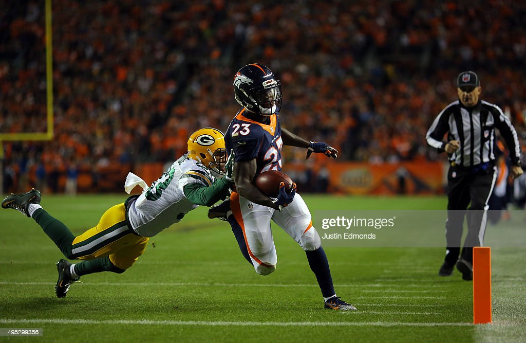 <a gi-track='captionPersonalityLinkClicked' href=/galleries/search?phrase=Ronnie+Hillman&family=editorial&specificpeople=7355403 ng-click='$event.stopPropagation()'>Ronnie Hillman</a> #23 of the Denver Broncos runs in a touchdown against <a gi-track='captionPersonalityLinkClicked' href=/galleries/search?phrase=Micah+Hyde+-+American+Football+Player&family=editorial&specificpeople=11470001 ng-click='$event.stopPropagation()'>Micah Hyde</a> #33 of the Green Bay Packers in the second quarter at Sports Authority Field at Mile High on November 1, 2015 in Denver, Colorado.