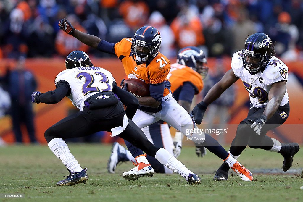 Ronnie Hillman #21 of the Denver Broncos runs the ball against Chykie Brown #23 and Dannell Ellerbe #59 of the Baltimore Ravens during the AFC Divisional Playoff Game at Sports Authority Field at Mile High on January 12, 2013 in Denver, Colorado.