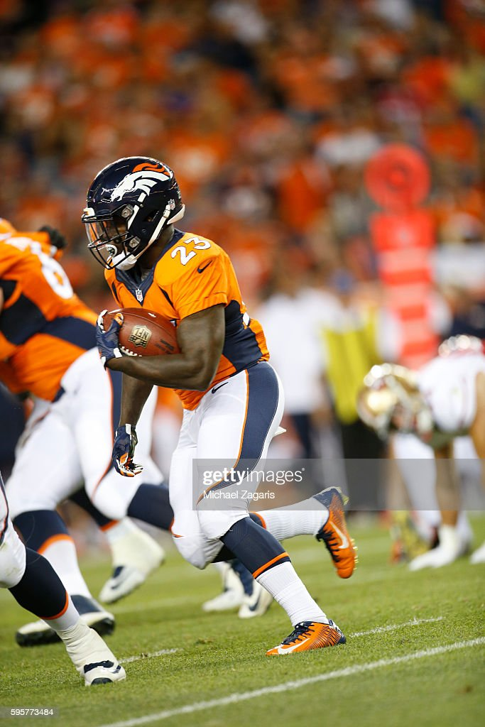Ronnie Hillman of the Denver Broncos rushes during the game against the San Francsico 49ers at Sports Authority Field on August 20 2016 in Denver...