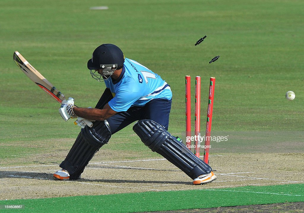 Ronnie Hira of Aces is bowled out by Joe Mennie of Perth during the Karbonn Smart CLT20 match between Auckland Aces and Perth Scorchers at SuperSport Park on October 23, 2012 in Pretoria, South Africa.