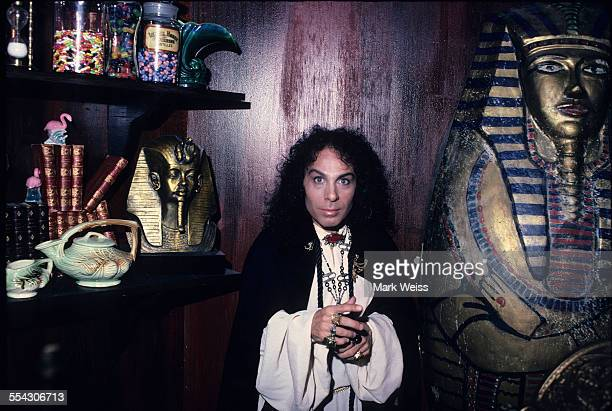 Ronnie James Dio portrait Egyptian style artifacts on the set of Dio's Rock and Roll Children video United States 1985