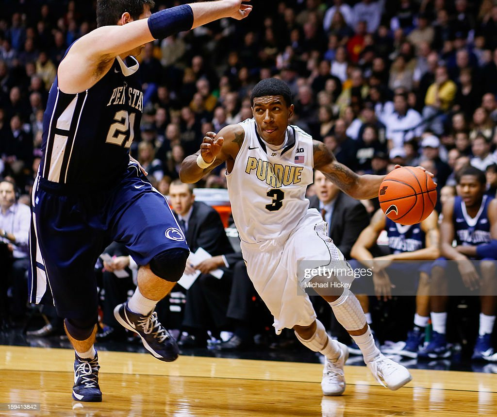 Ronnie Johnson #3 of the Purdue Boilermakers dribbles to the basket against Sasa Borovnjak #21 of the Penn State Nittany Lions at Mackey Arena on January 13, 2013 in West Lafayette, Indiana. Purdue defeated Penn State 60-42.