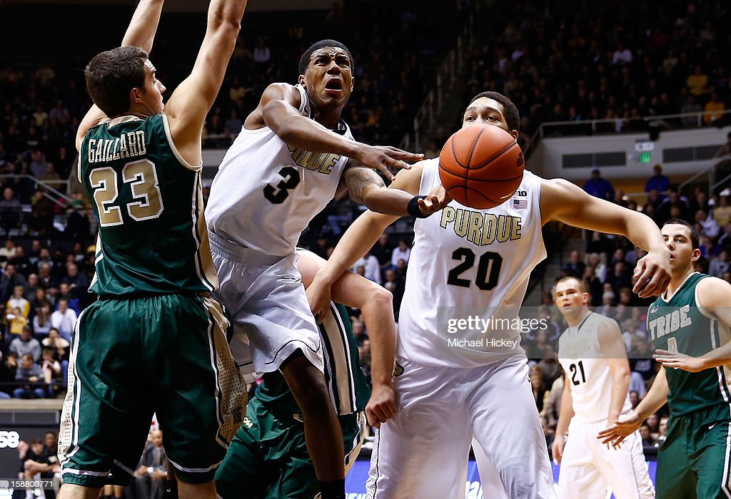 Ronnie Johnson #3 of the Purdue Boilermakers loses the ball as he shoots against Kyle Gaillard #23 of the William & Mary Tribe at Mackey Arena on December 29, 2012 in West Lafayette, Indiana. Purdue defeated William & Mary 73-66.