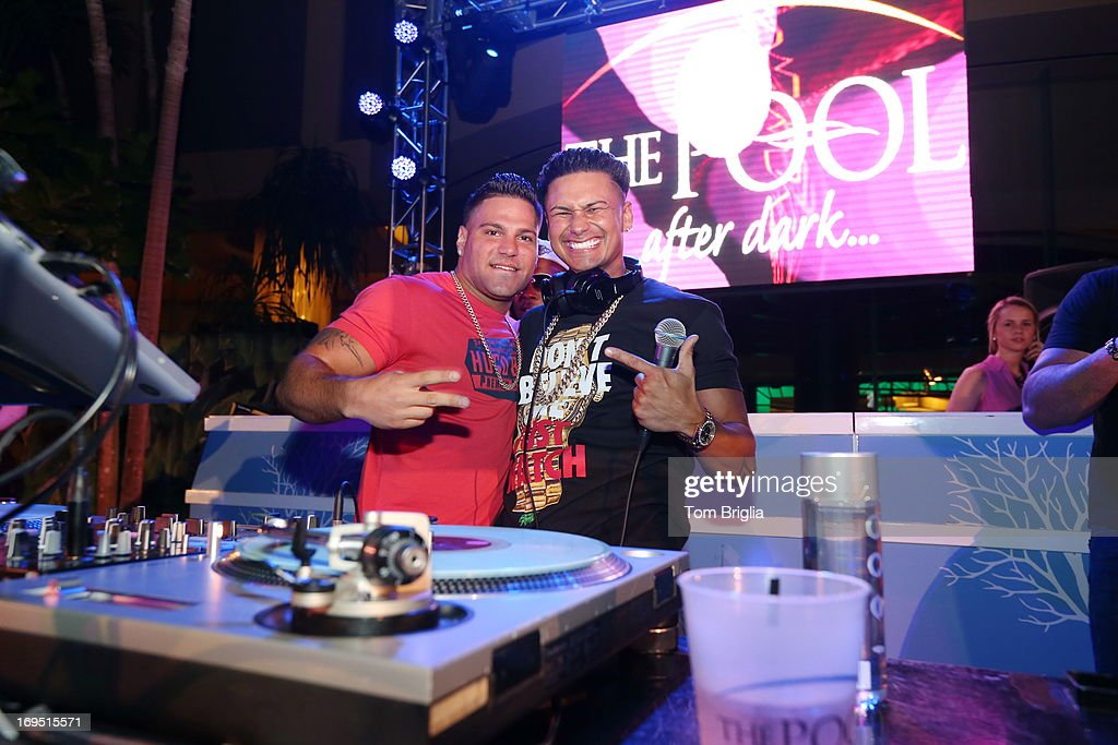 Ronnie joins (R) DJ Pauly D on stage while performing at The Pool After Dark at Harrah's Resort on Saturday May 25, 2013 in Atlantic City, New Jersey.