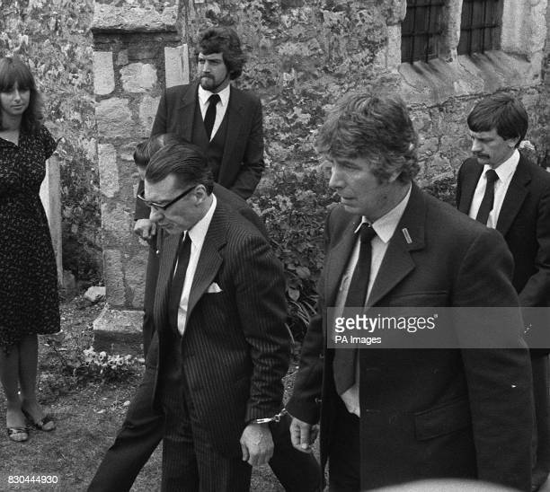 Ronnie Kray handcuffed to a prison officer at Chingford Old Church East London where he attended the funeral of his mother Mrs Violet Kray Ronnie and...