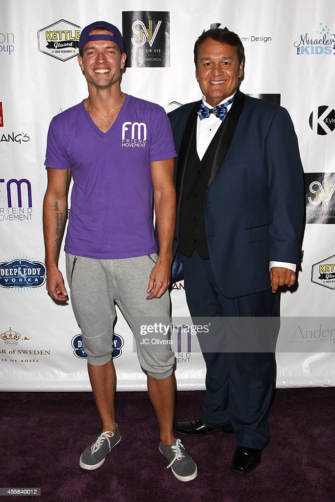 Ronnie Kroell and Eddie Lobo attend Friend Movement's Stardust Soiree at Madame Tussauds on September 20 2014 in Hollywood California