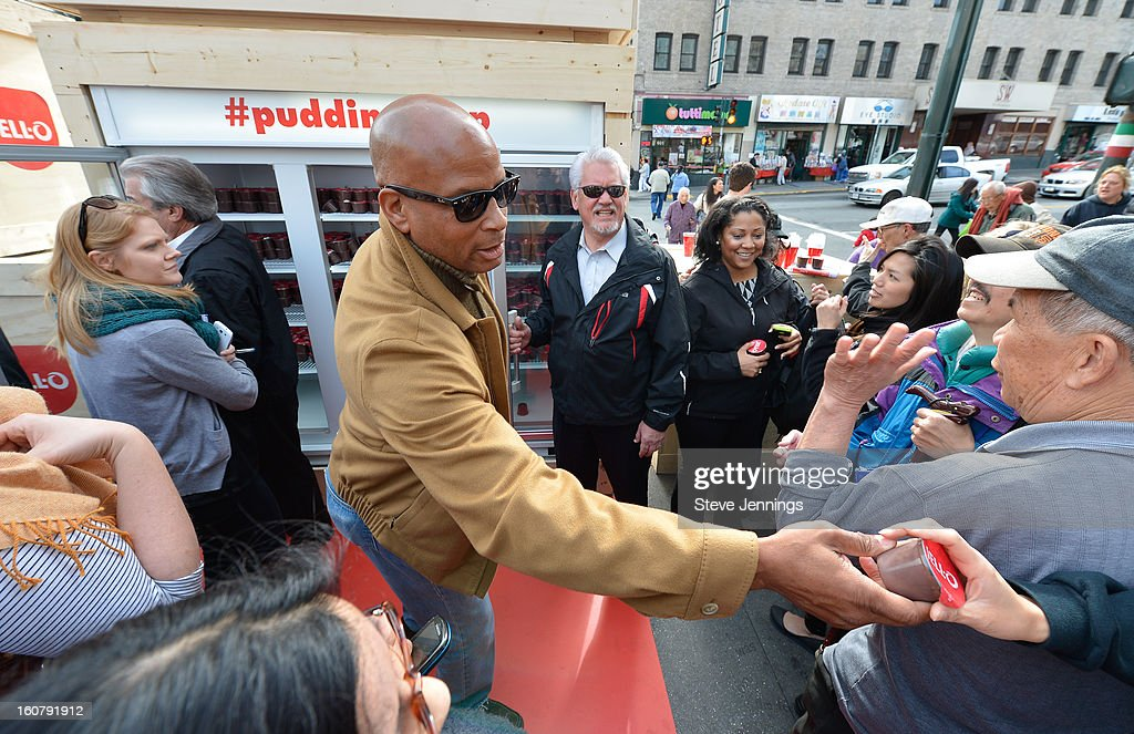 Ronnie Lott hands out JELL-O Pudding at the JELL-O Make The Taste of Defeat Sweet on February 5, 2013 in San Francisco, California.