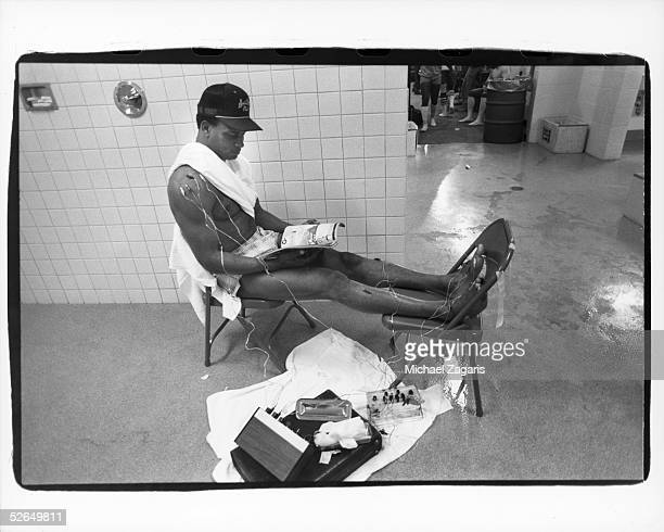 Ronnie Lott of the San Francisco 49ers applies electronic acupuncture to his body during the pregame period before their game against the Miami...
