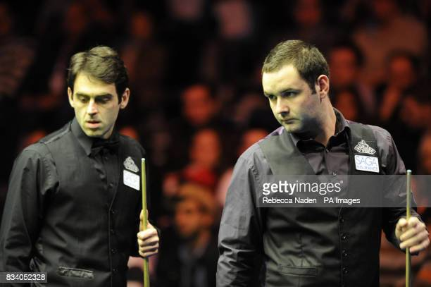 Ronnie O'Sullivan and Stephen Maguire during the SAGA Insurance Masters at Wembley Arena London