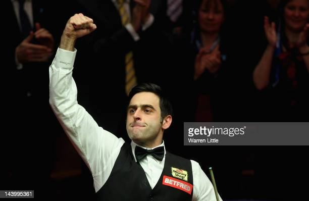 Ronnie O'Sullivan celebrates beating Allister Carter of England to win the Betfredcom World Snooker Championship at the Crucible Theatre on May 7...