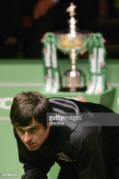 Ronnie O'Sullivan eyes his next shot during his Semi Final match against Greame Dott during the 888com World Championship at the Crucible Theatre on...
