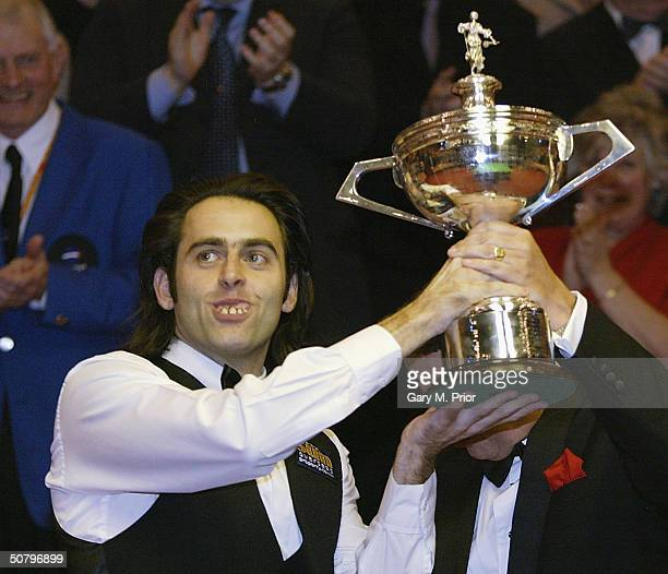Ronnie O'Sullivan holds aloft the trophy after winning the Embassy World Snooker Final between Ronnie O'Sullivan and Graeme Dott at the Crucible...