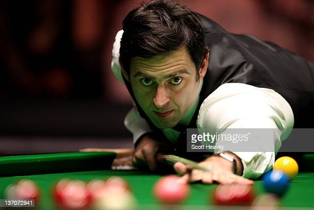 Ronnie O'Sullivan in action against Ding Junhui during day one of the Masters at Alexandra Palace on January 15 2012 in London England