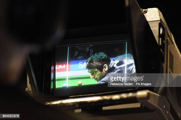 Ronnie O'Sullivan in action filmed on a television camera during the SAGA Insurance Masters at Wembley Arena London