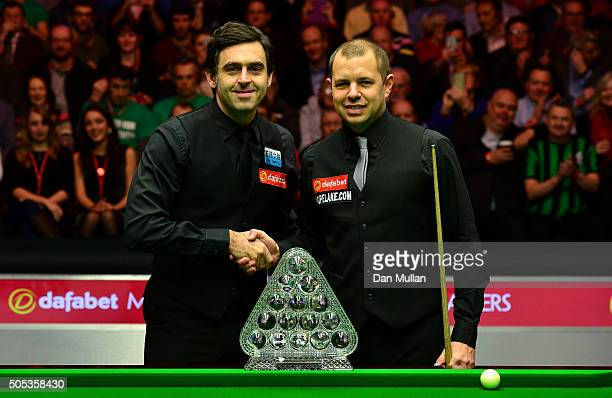 Ronnie O'Sullivan of England and Barry Hawkins of England pose with the Dafabet Masters trophy ahead of the Final match during Day Eight of The...