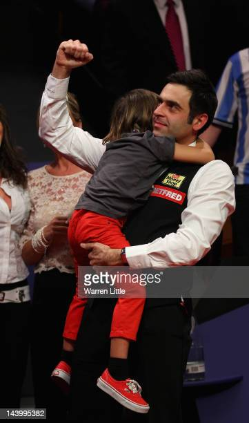 Ronnie O'Sullivan of England celebrates beating Allister Carter of England to win the Betfredcom World Snooker Championship at the Crucible Theatre...
