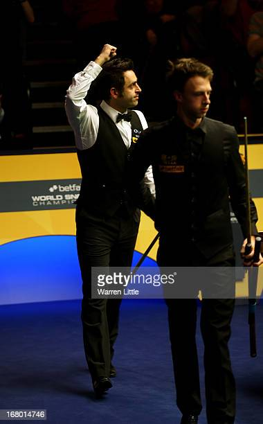 Ronnie O'Sullivan of England celebrates beating Judd Trump of England during the Semi Final match of the Betfair World Snooker Championship at the...
