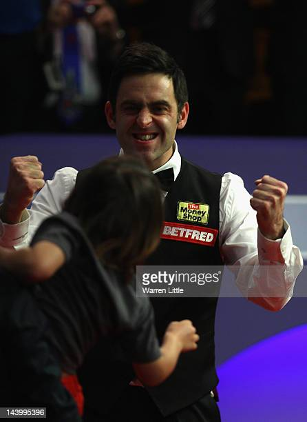 Ronnie O'Sullivan of England celebrates to his son Ronnie after beating Allister Carter of England to win the Betfredcom World Snooker Championship...