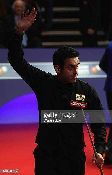 Ronnie O'Sullivan of England celebrates winning his semi final match against Matthew Stevens of Wales during the Betfredcom World Championship at...