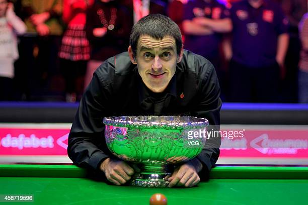 Ronnie O'Sullivan of England celebrates with his trophy after winning the final match against Judd Trump of England on day six of the 2014 Dafabet...