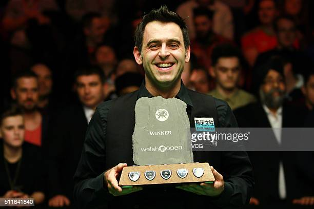 Ronnie O'Sullivan of England celebrates with the trophy after winning the final match against Neil Robertson of Australia on day seven of BetVictor...