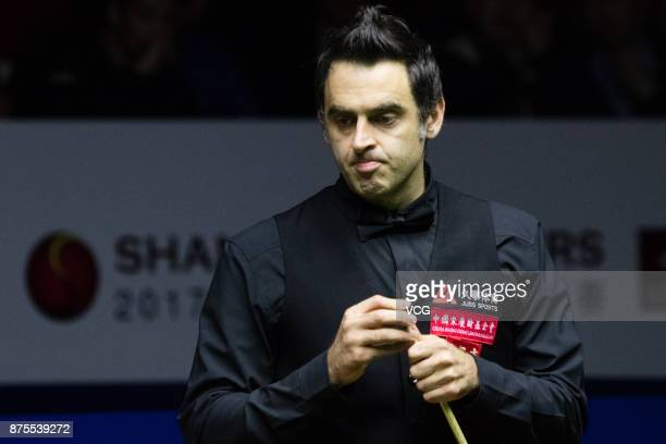 Ronnie O'Sullivan of England chalks the cue during the semifinal match against John Higgins of Scotland on day five of 2017 Shanghai Masters at...