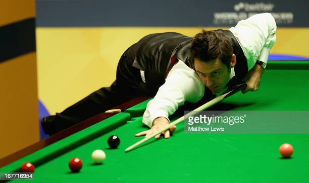 Ronnie O'Sullivan of England in actio against Alister Carter of England during second round match of the Betfair World Snooker Championship at the...
