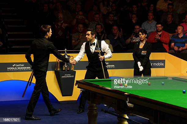 Ronnie O'Sullivan of England is congratulated by Judd Trump of England after winning the Semi Final match of the Betfair World Snooker Championship...