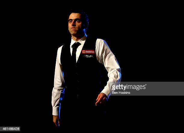 Ronnie O'Sullivan of England makes his way into the arena during his first round match against Ricky Walden of England on day three of The Dafabet...