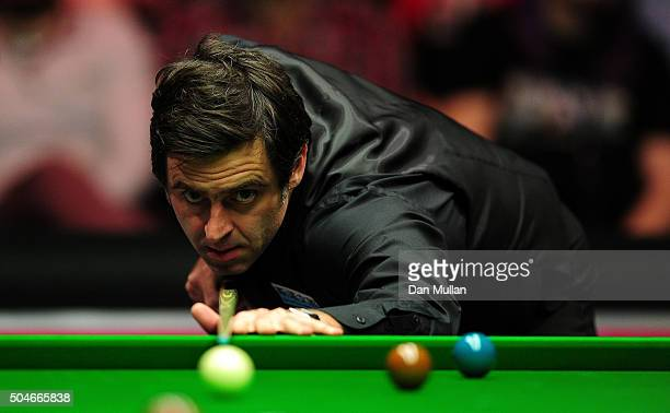 Ronnie O'Sullivan of England plays a shot during his round one match against Mark Williams of Wales on Day Three of The Dafabet Masters at Alexandra...