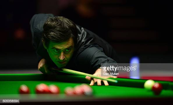 Ronnie O'Sullivan of England plays a shot during the Final match against Barry Hawkins of England during Day Eight of The Dafabet Masters at...