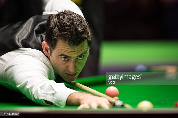 Ronnie O'Sullivan of England plays a shot during the quarterfinal match against Mark J Williams of Wales on day 11 of Betway UK Championship 2016 at...