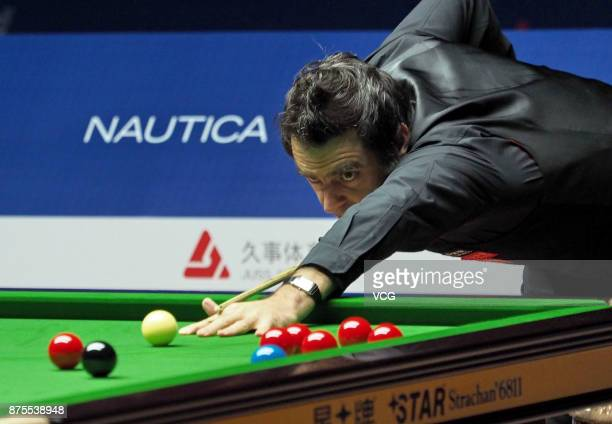 Ronnie O'Sullivan of England plays a shot during the semifinal match against John Higgins of Scotland on day five of 2017 Shanghai Masters at...
