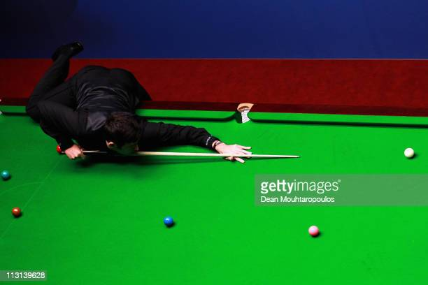 Ronnie O'Sullivan of England plays a shot in the round two game against Shaun Murphy of England on day nine of the Betfredcom World Snooker...