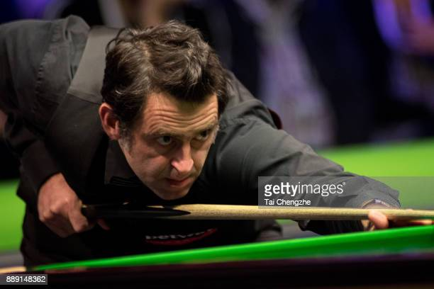 Ronnie O'Sullivan of England plays a shot in the semifinal match against Stephen Maguire of Scotland during 2017 Betway UK Championship at Barbican...
