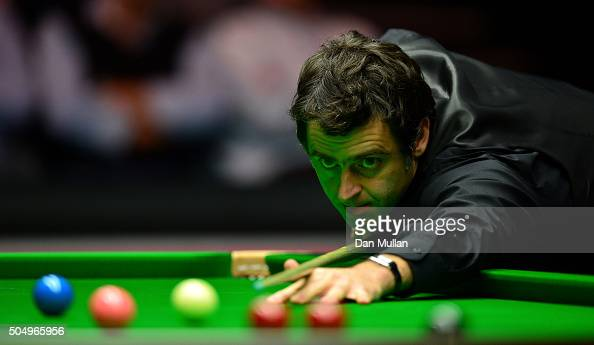 Ronnie O'Sullivan of England plays during his quarter final match against Mark Selby of England during day five of The Dafabet Masters at Alexandra...